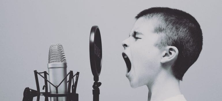 a boy screaming into the microphone