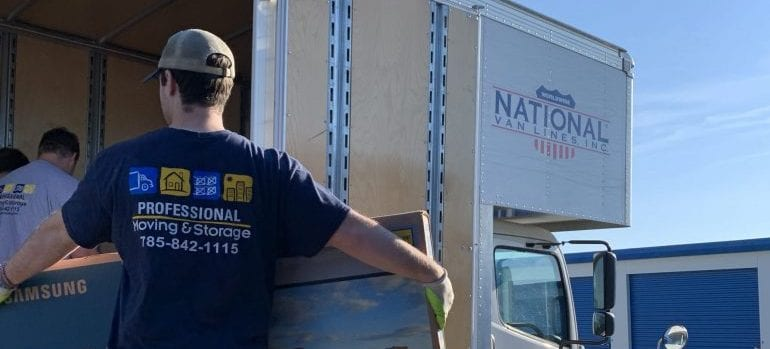 movers loading the truck of Kansas long distance movers