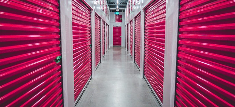 A storage facility with red doors