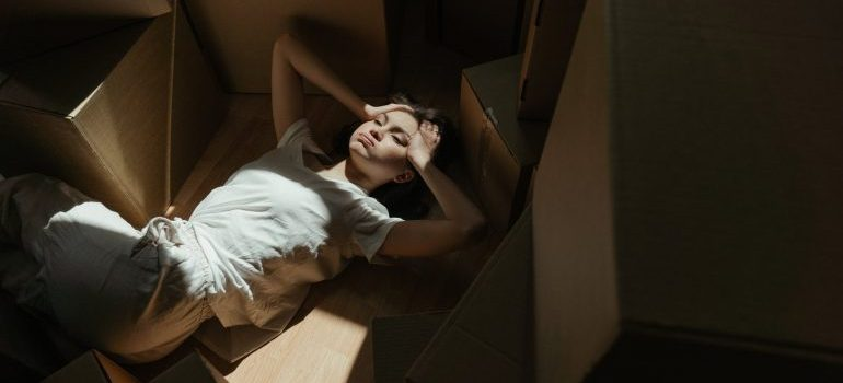 woman laying between the boxes